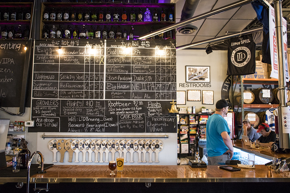 LTD Brewing Company's rotating taps and taproom // Photo by Tj Turner