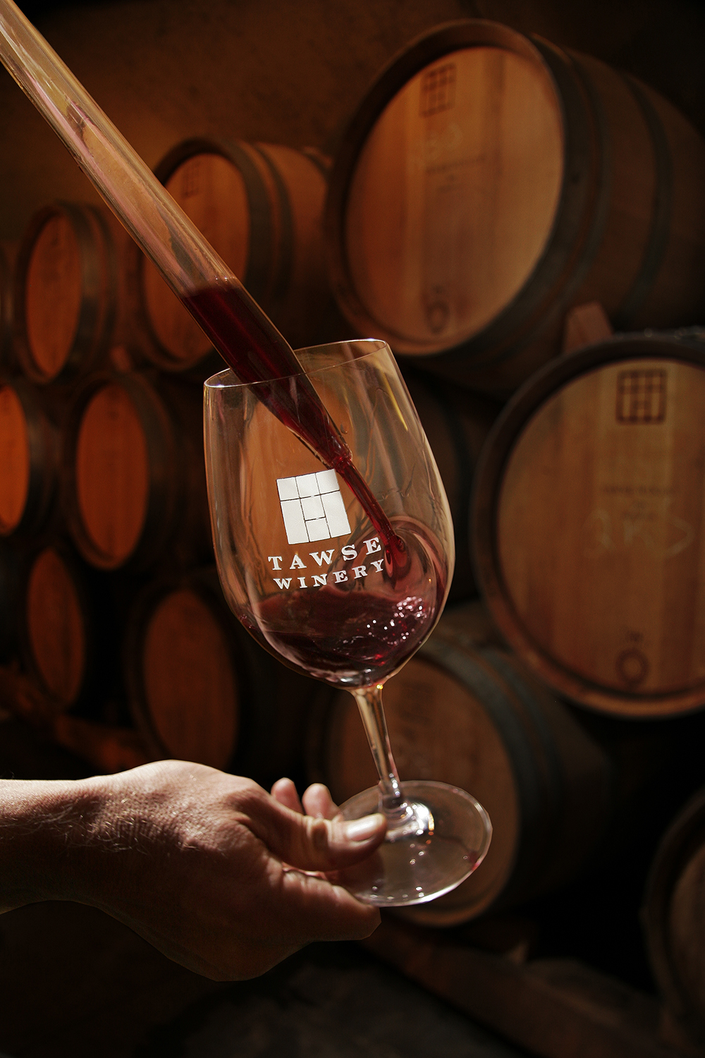 Wine is poured from a wine thief into a glass at Tawse Winery // Photo courtesy Tawse Winery
