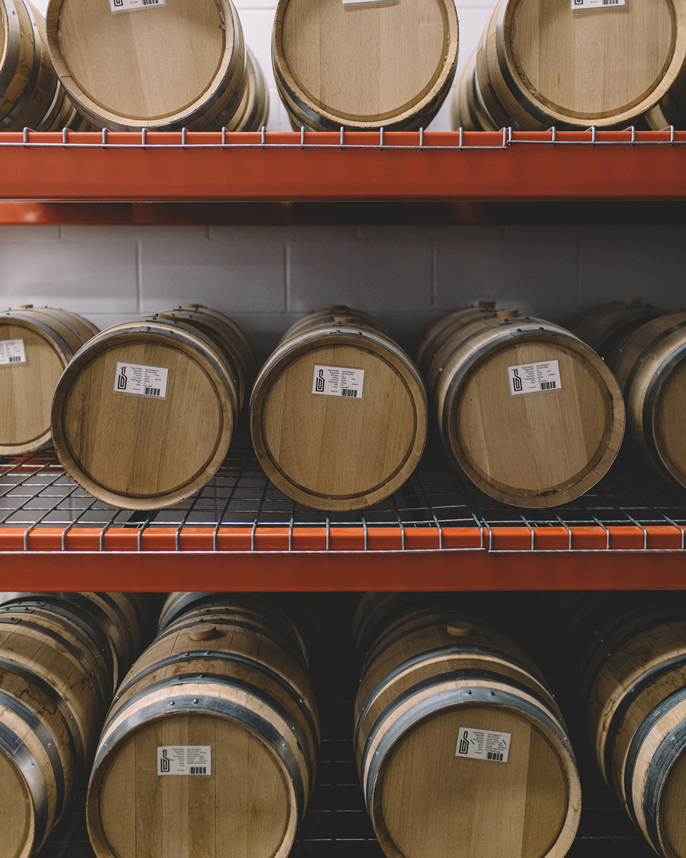 Some of the varying sizes of barrels used for aging at Studio Distilling // Photo by Sam Ziegler