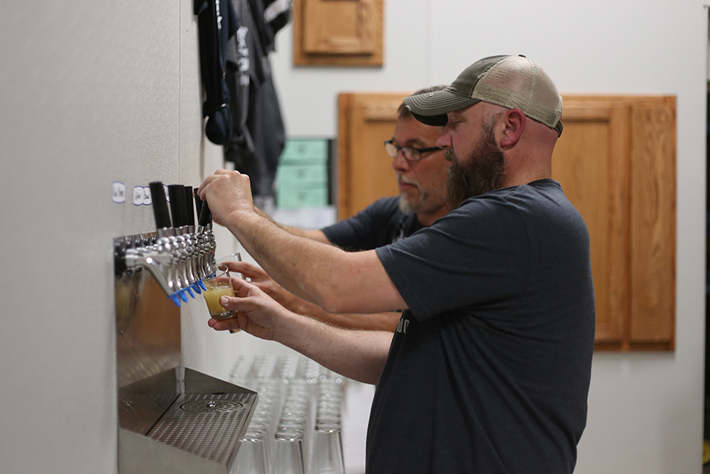 Co-owners and brewers Joe Bower (front) and Kevin Jones (back) // Photo by Louis Garcia