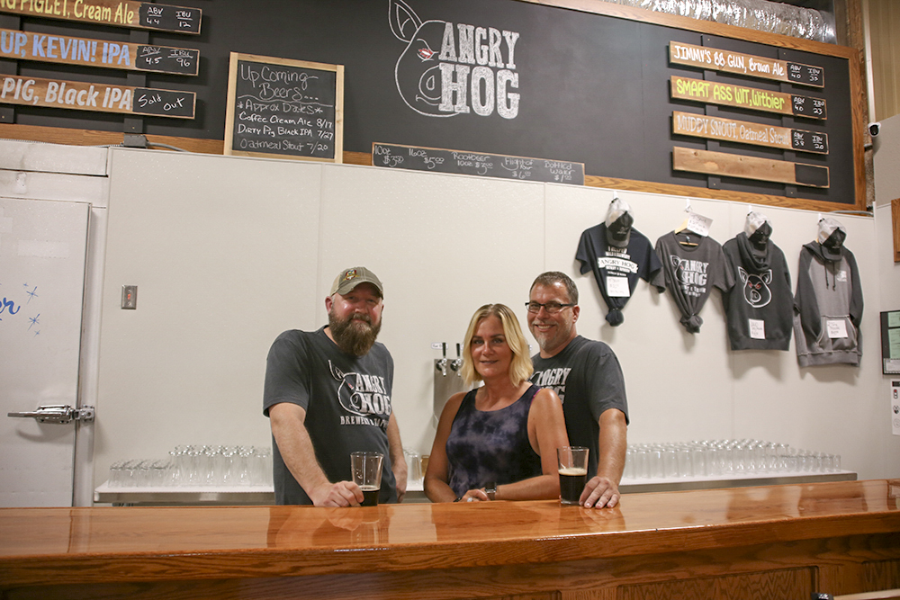 Angry Hog Brewery & Taproom's founders (L to R), Joe Bowers Jill and Kevin Jones // Photo by Louis Garcia