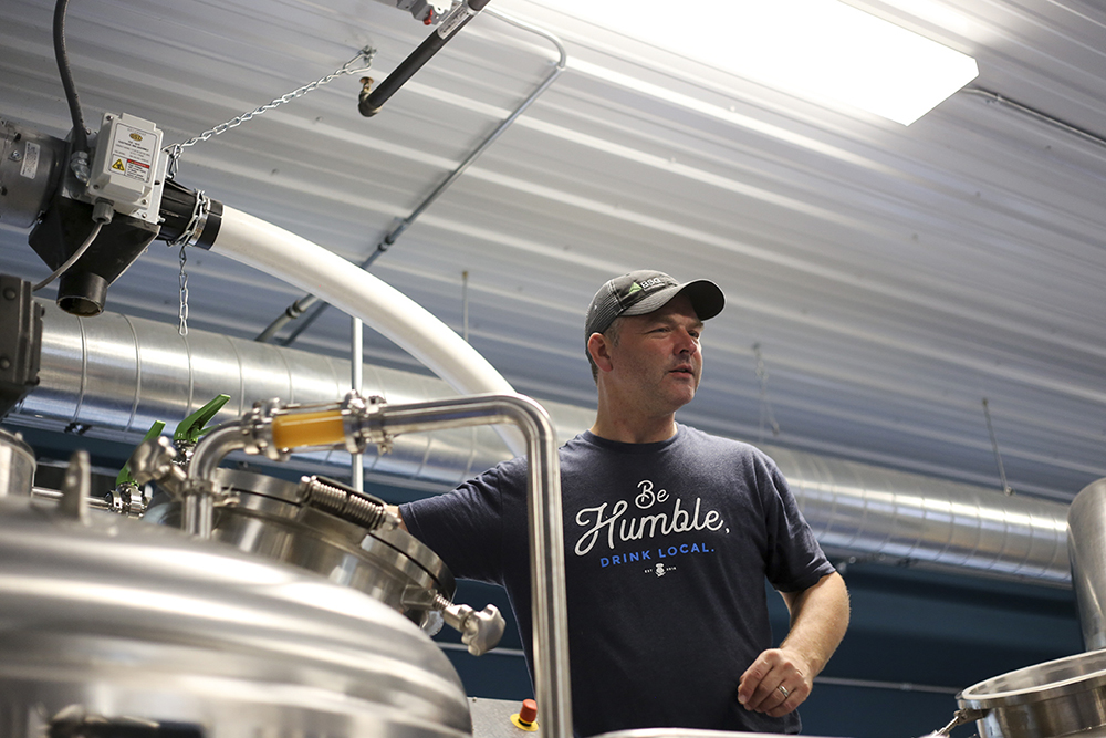 Steve Finnie is back on top of the brew deck making a batch of beer at his new brewing venture, Little Thistle Brewin Co. in Rochester, Minnesota // Photo by Louis Livingston-Garcia