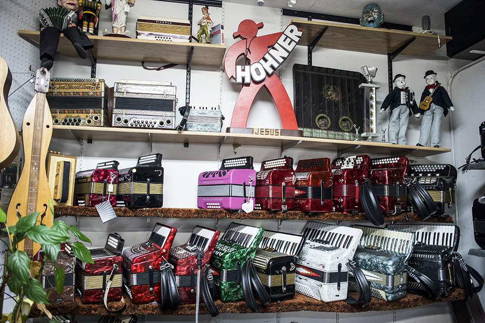 An assortment of accordions on display inside Ken's shop // Photo by Tj Turner