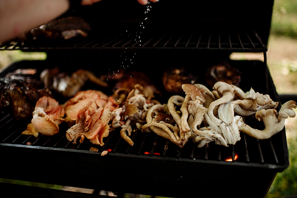 Mushrooms being salted on the grill // Photo by Becca Dilley