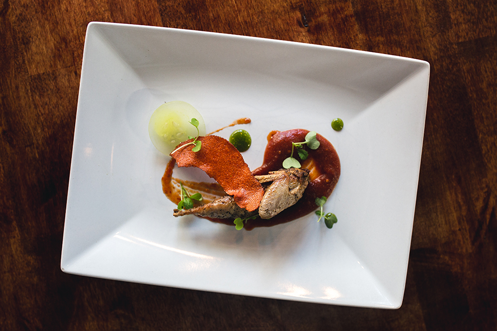 The half quail with sriracha paper, tomato, cucumber and thai basil // Photo by Sam Ziegler