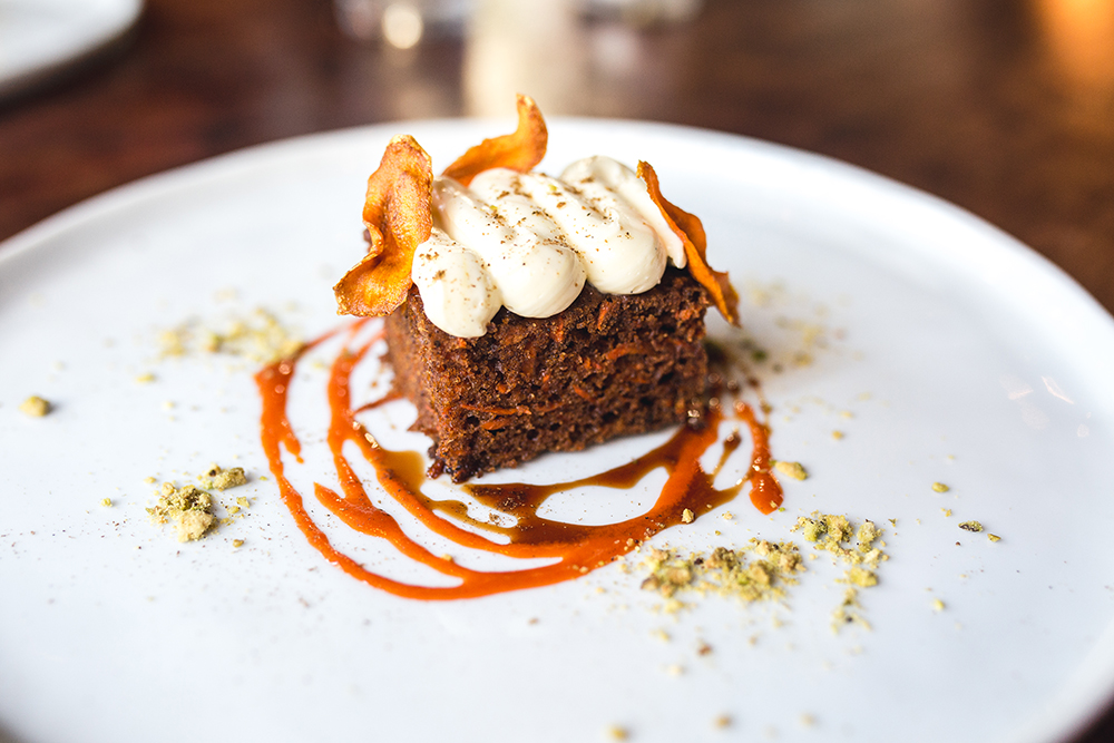 Indian spiced carrot cake with saffron orange blossom cream cheese, carrot caramel, carrot chips and pistachio // Photo by Sam Ziegler