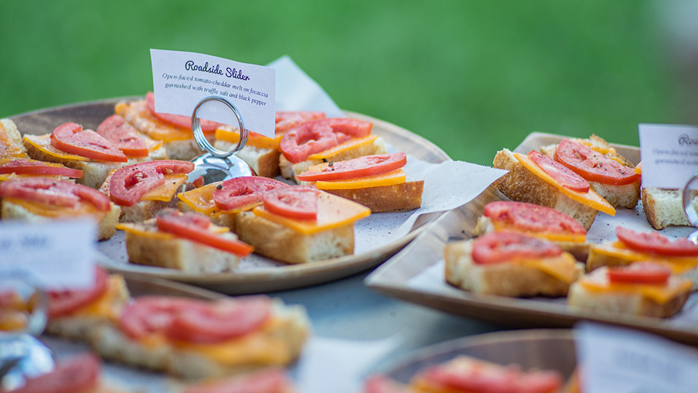"""A """"Roadside Slider"""" was offered at the performance of """"Escape from Alcina's Island"""". It was an open-faced tomato-cheddar melt on focaccia bread, garnished with truffle salt and black pepper // Photo courtesy Picnic Operetta"""