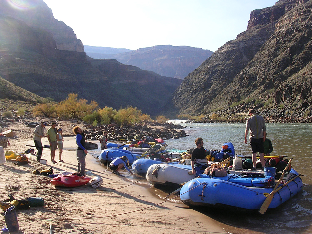 Hancock's crew with their rafts tied to the shore of the Colorado River // Photo by James Hancock