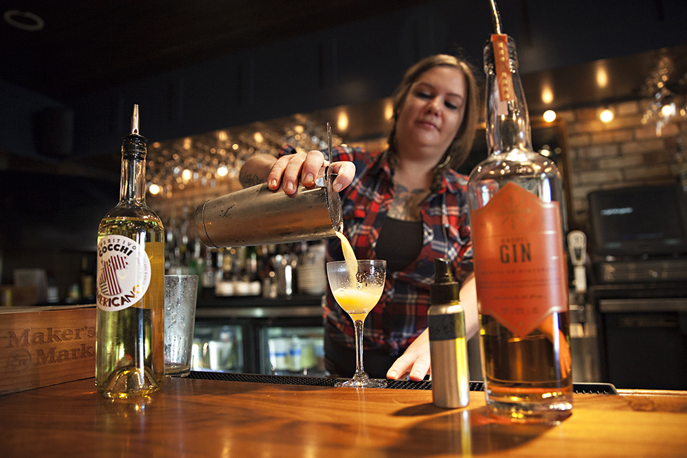 "Olivia Engel, a bartender at Nightingale, pouring the ""God Save The Queen"" cocktail // Photo by Katie Cannon"