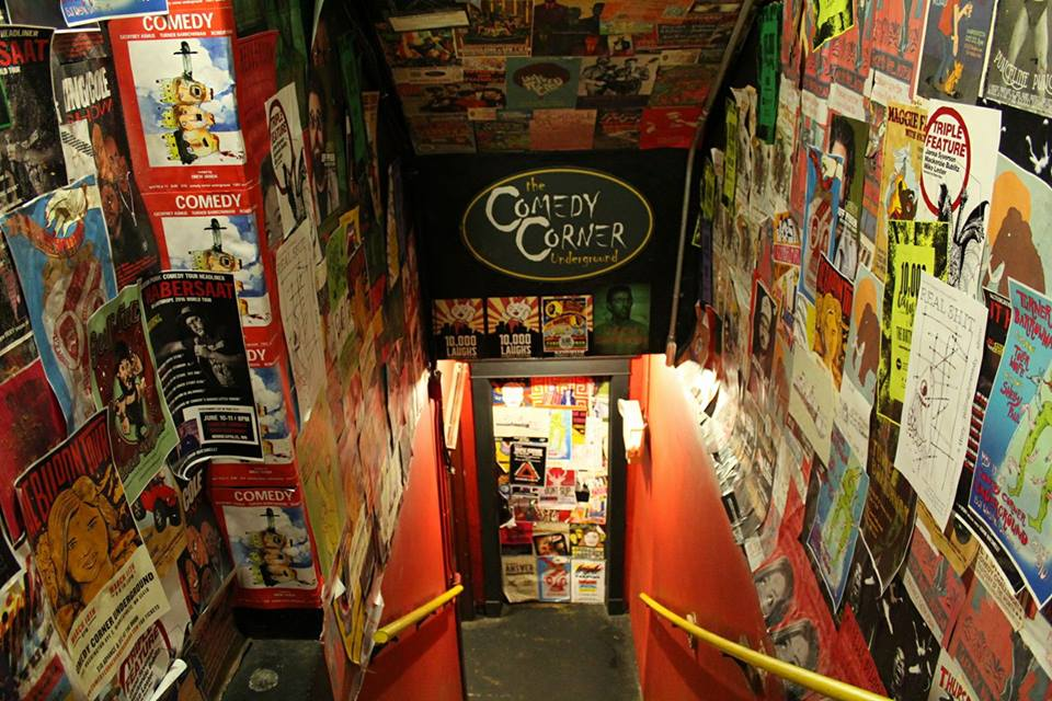 The stairs leading to the Comedy Corner Underground stage, below the Corner Bar on Washington Avenue in Minneapolis, Minnesota // Photo via The Comedy Corner Underground Facebook