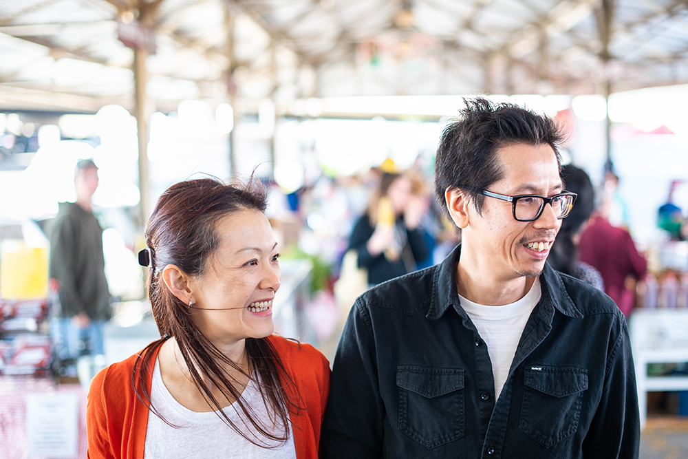 Lina Goh and John Ng at the downtown St. Paul Farmer's Market // Photo by Kevin Kramer