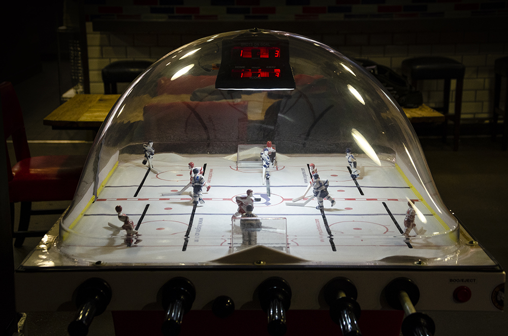 A SuperChex bubble hockey game at Rival House in downtown St. Paul, Minnesota // Photo by Aaron Job