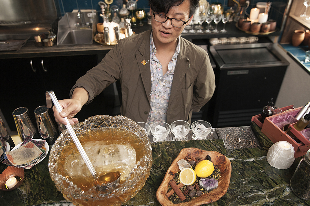Nguyen scooping the punch after letting it chill on ice before serving // Photo by Katie Cannon