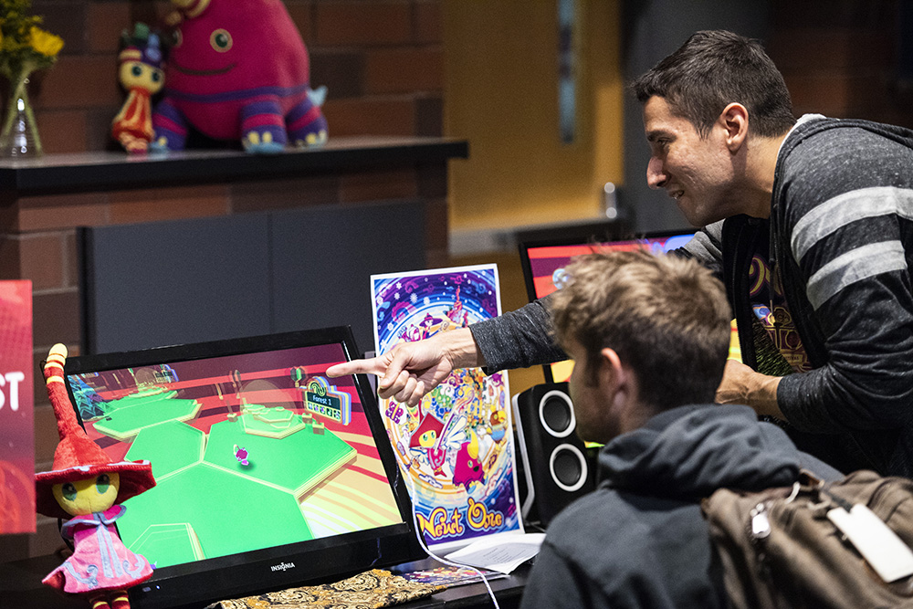 Attendees of the Minnecade event 2018 play Newt One, a game by DevNari // Photo by Matt Mead