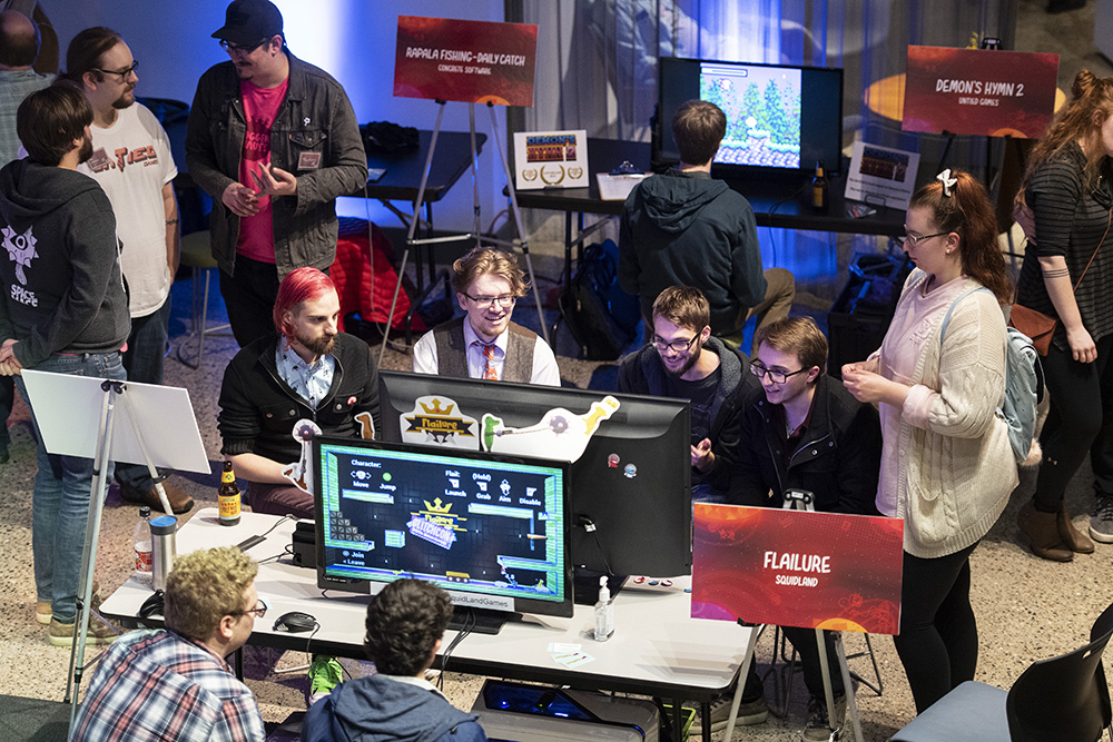 Minnecade attendees testing and playing a variety of locally developed games // Photo by Matt Mead