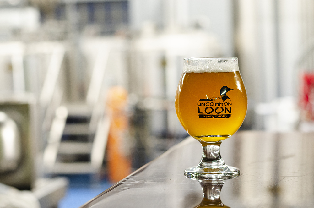 A tulip glass with one of the starting beers on tap at Uncommon Loon Brewing Company // Photo by Aaron Job