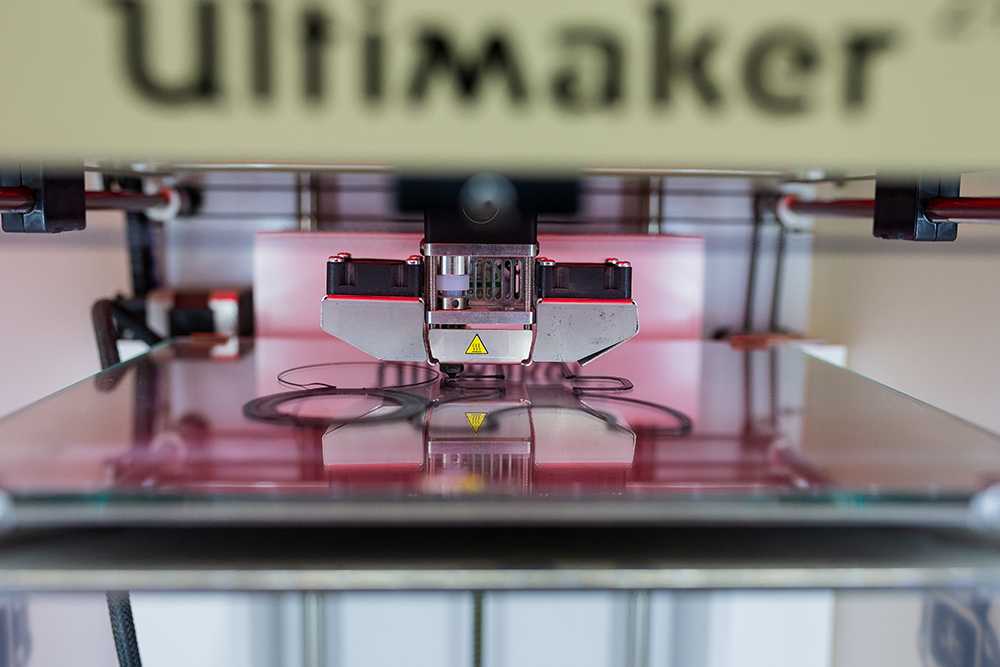 A 3D printer at MCAD creating an artist's design // Photo by Harrison Barden
