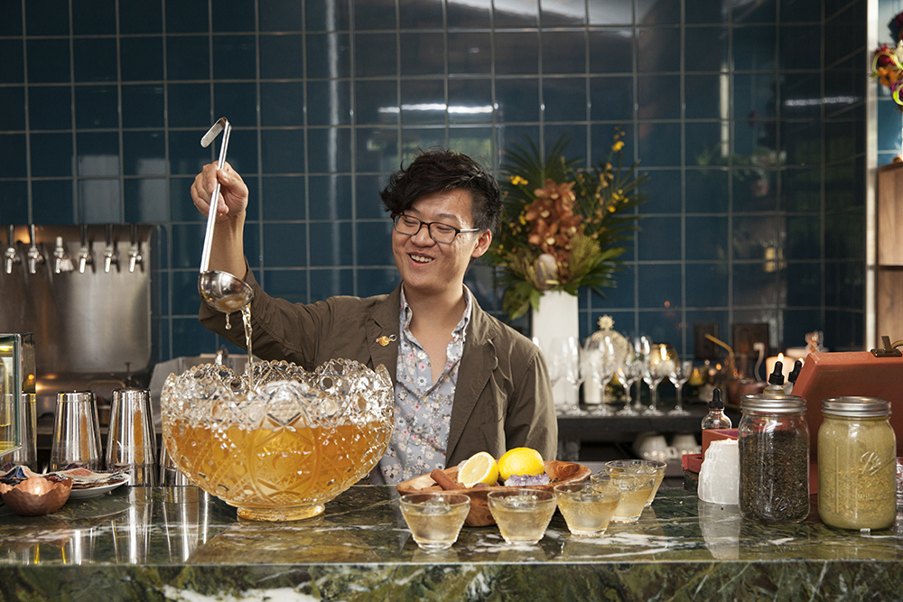 Dustin Nguyen ladles punch at Martina // Photo by Katie Cannon