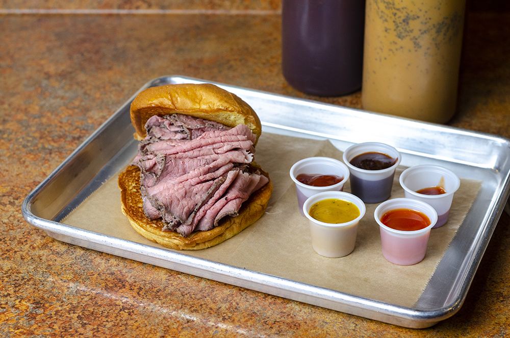 Maverick's Real Roast Beef Sandwich with various sauces // Photo by Aaron Job