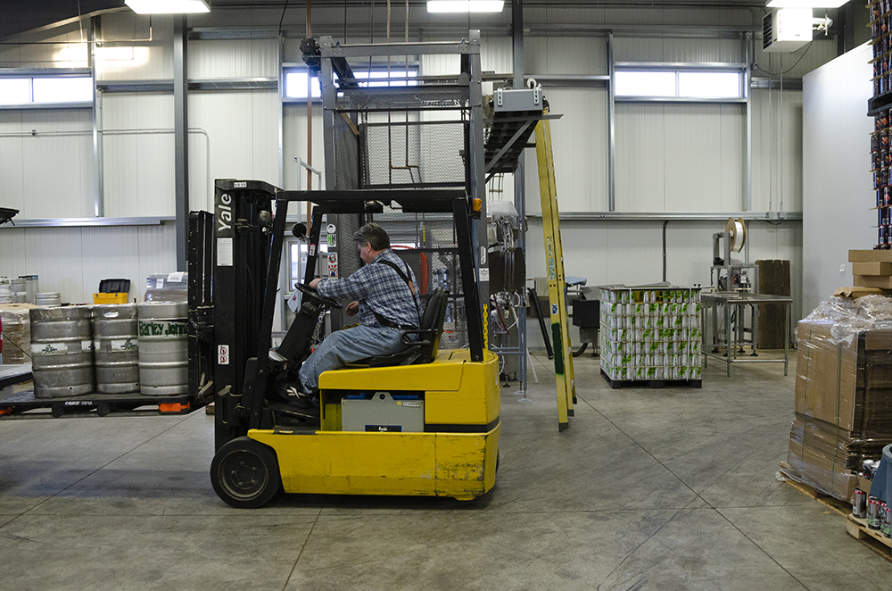 A forklift being operated in the Barley John's Brewing space in New Richmond, Wisconsin // Photo by Aaron Job