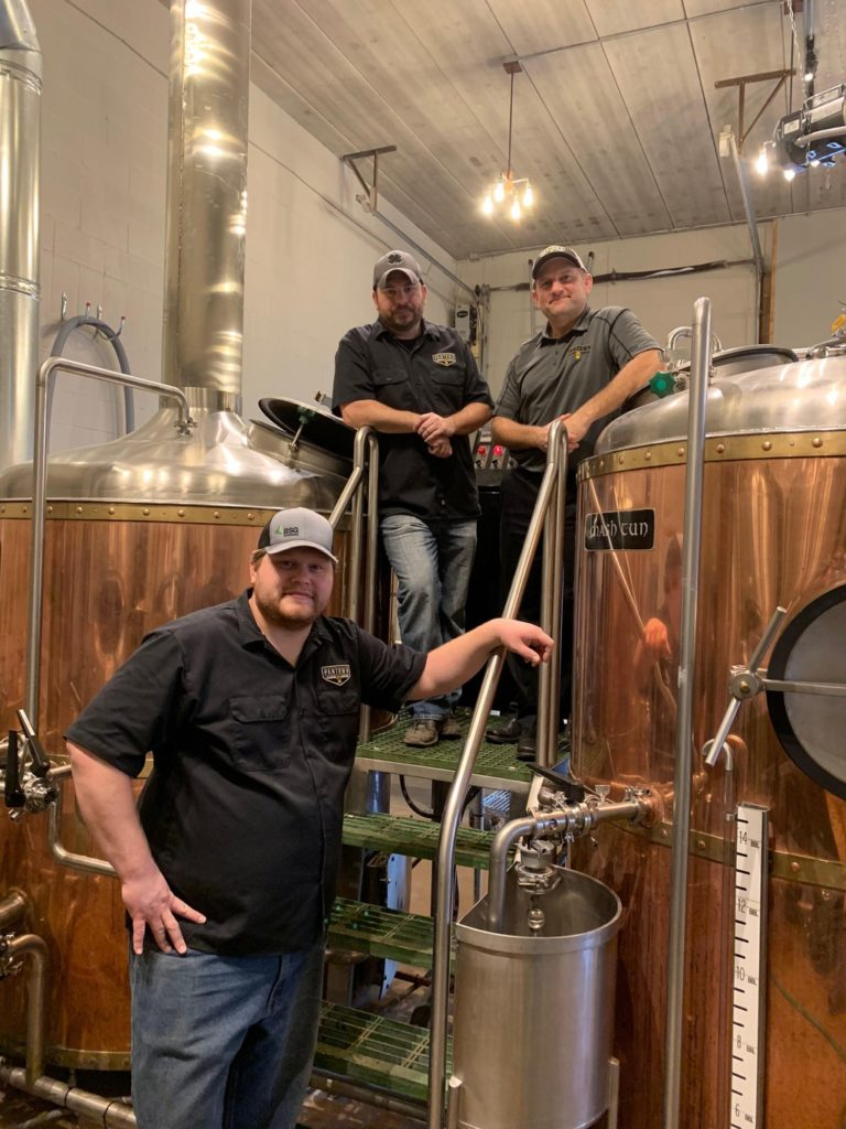 From front, left to right, Nick Flies, head brewer, Marty Czech, owner and Noel Johnson, founder of Pantown Brewing Company // Photo via Pantown Brewing Company Website