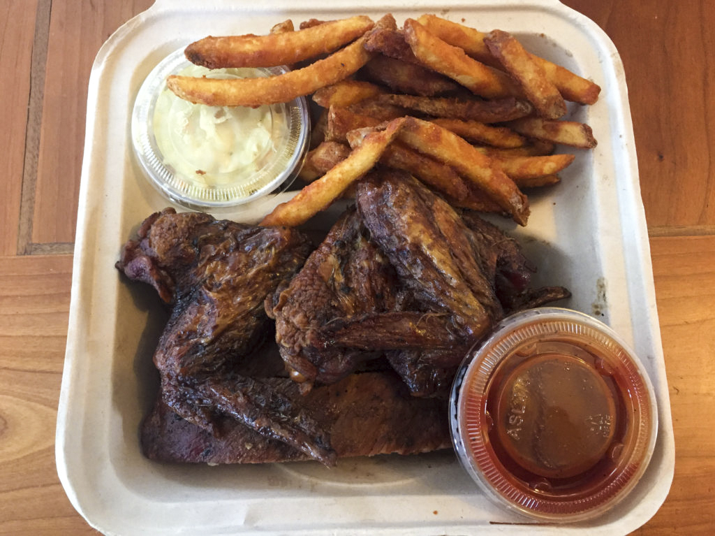 The Ribs and Wings Combo with coleslaw at Smoke in the Pit // Photo by James Norton