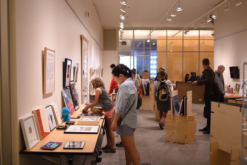Minneapolis Art Lending Library borrowers at the summer 2018 lending event hosted at Minneapolis Central Library // Photo courtesy Minneapolis Art Lending Library