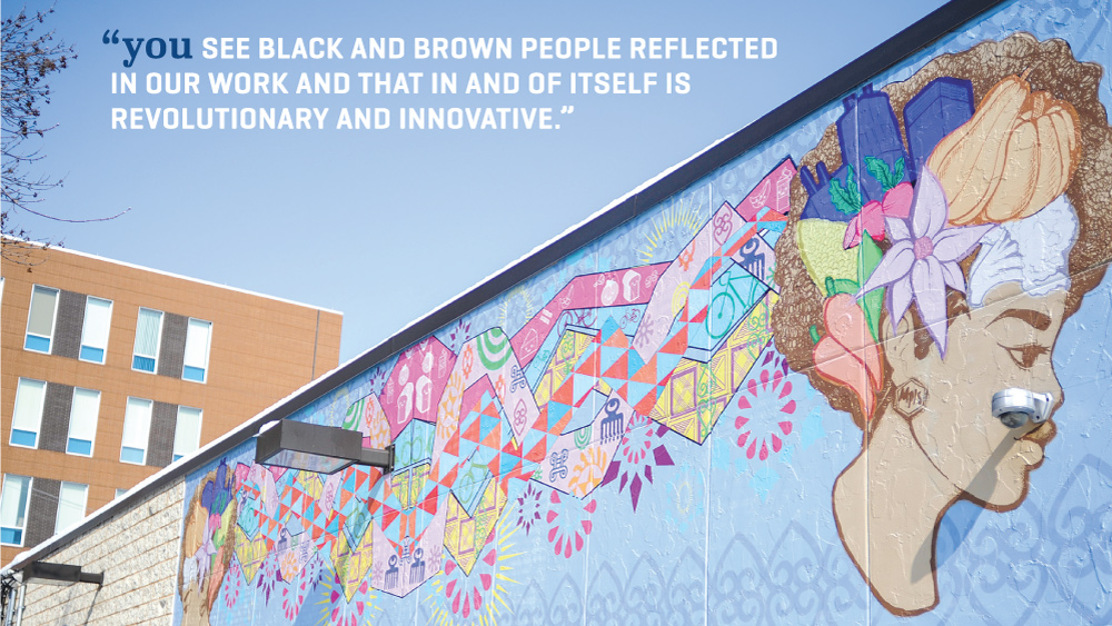 A JXTA mural on the side of Breaking Bread Cafe in North Minneapolis // Photo by Daniel Murphy