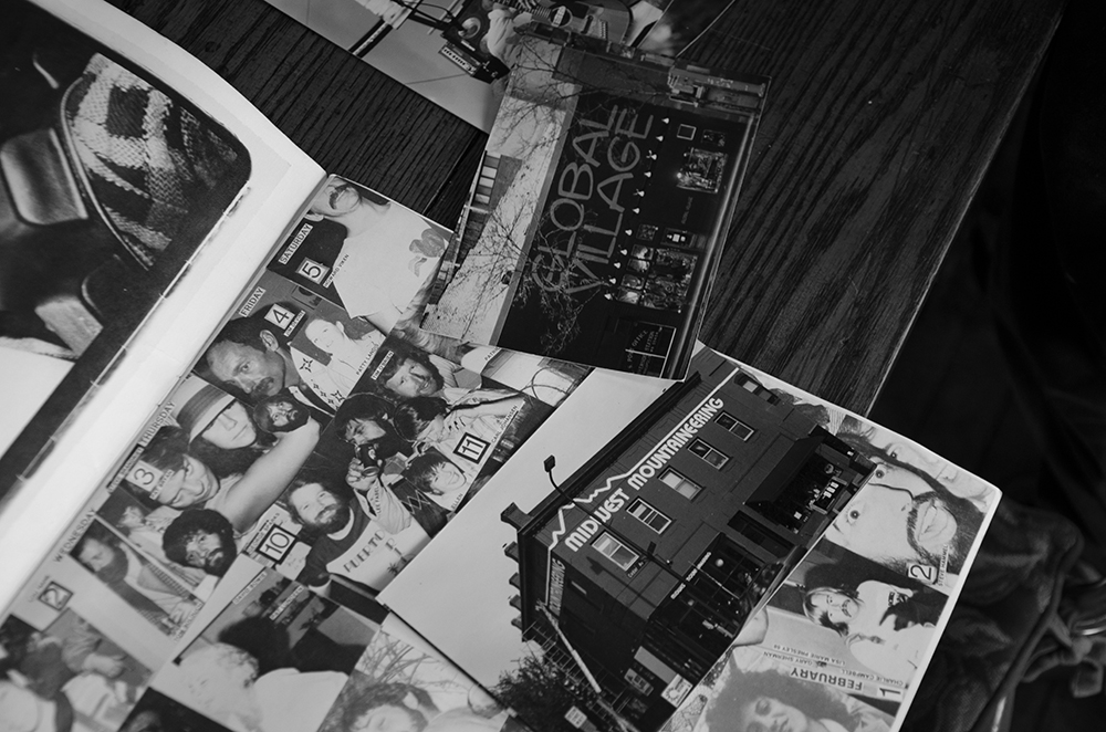 Top: Phil, who originally went to school to become a photographer, keeps an extensive record of his work. The box shown here is one of many Phil keeps in his basement. It's filled with negatives, slides, and photographs from when he was younger and of his career as a sign painter. Bottom: As Phil was showing me pictures of his work, he came across an birthday calendar from '79 that an amateur photographer friend had given him. It highlights the West Bank during that time, with pictures of parties, the drag queen Divine, and musician Bonnie Raitt // Photos by Aaron Job