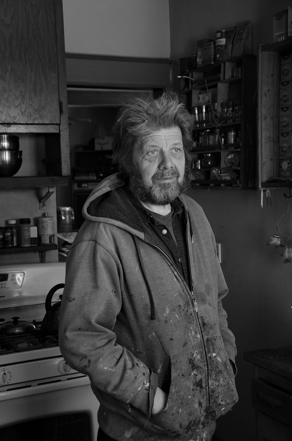 Phil stands in the kitchen of his home in South Minneapolis // Photo by Aaron Job