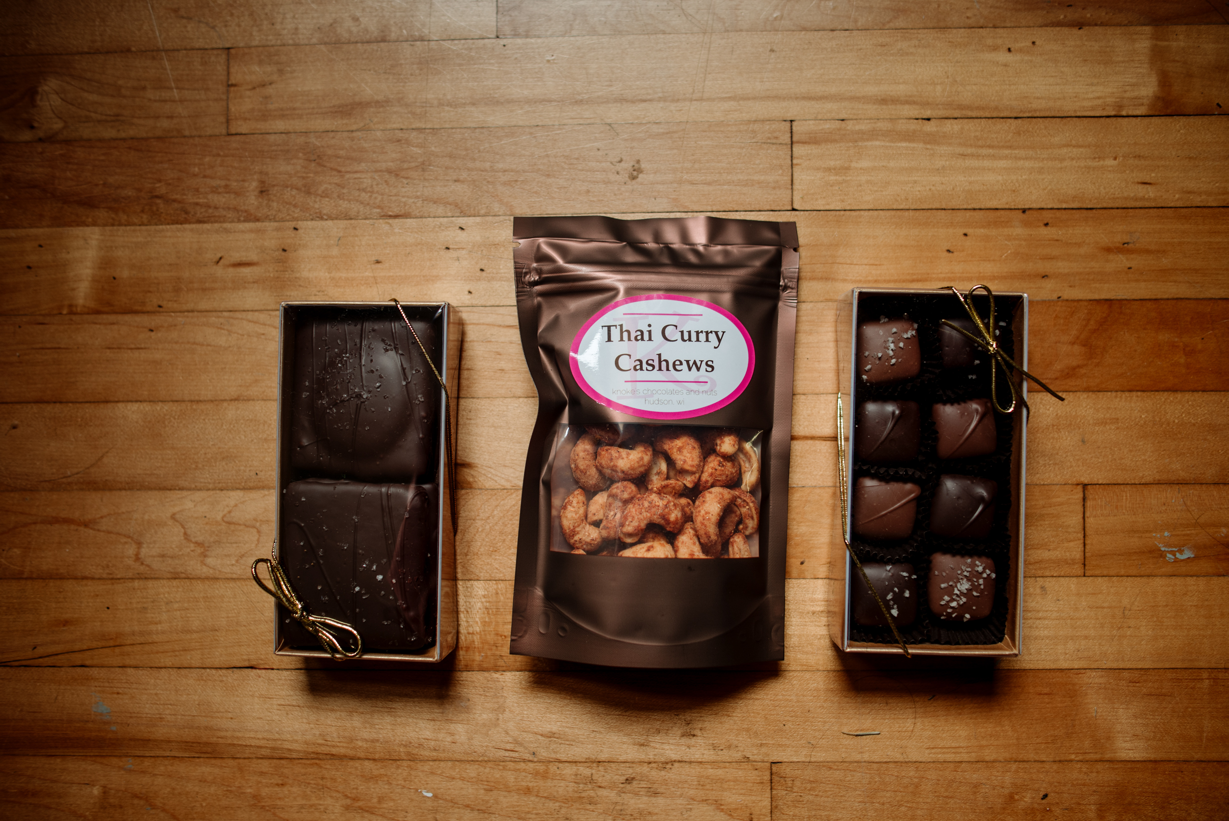 A medley of Caramel Graham Crackers, Thai Curry Cashews, & eight piece Box of Caramels// Photo by Becca Dilley