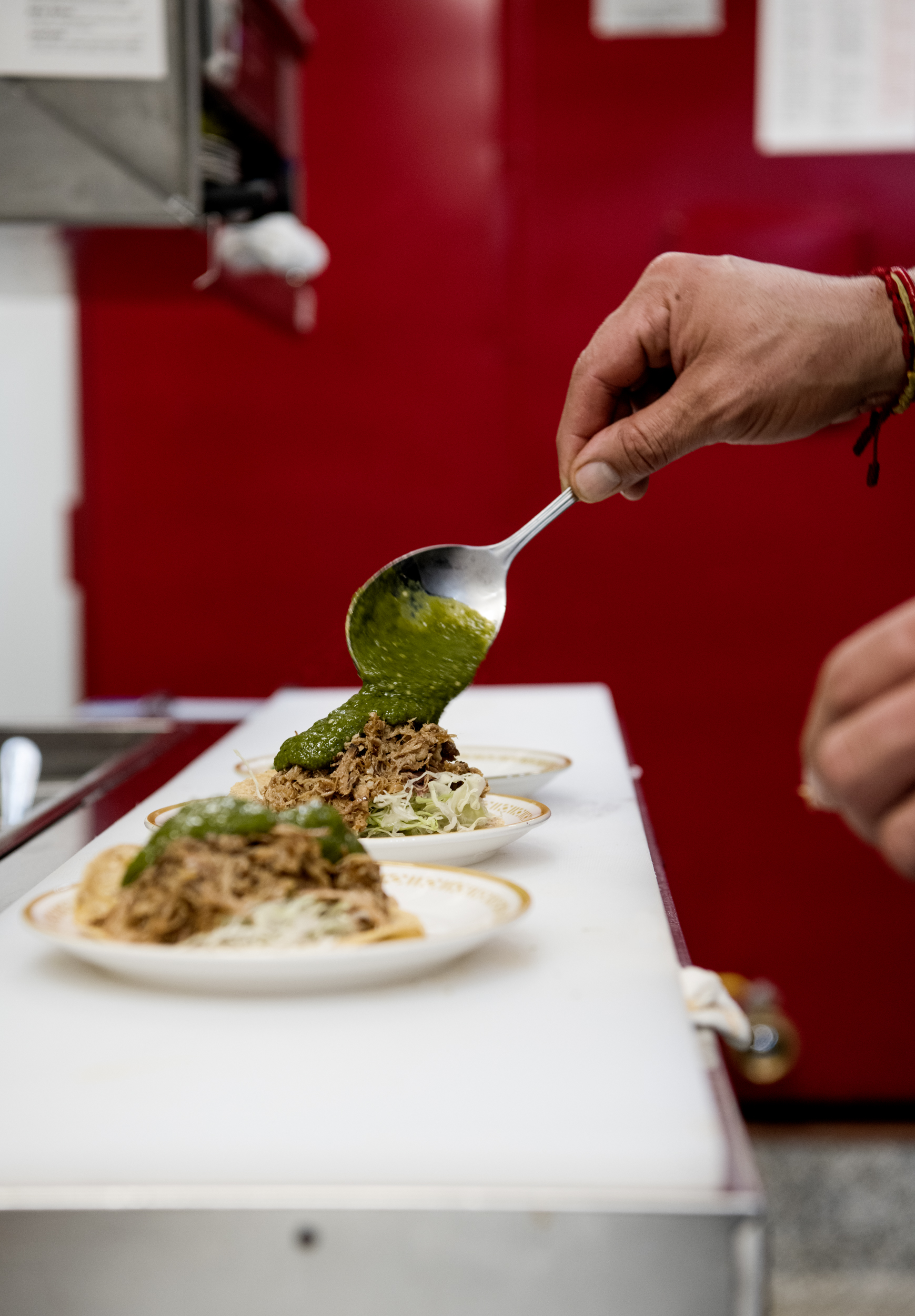 Alejandro Castillon plates tacos in the kitchen of Prieto // Photo by Victoria Campbell