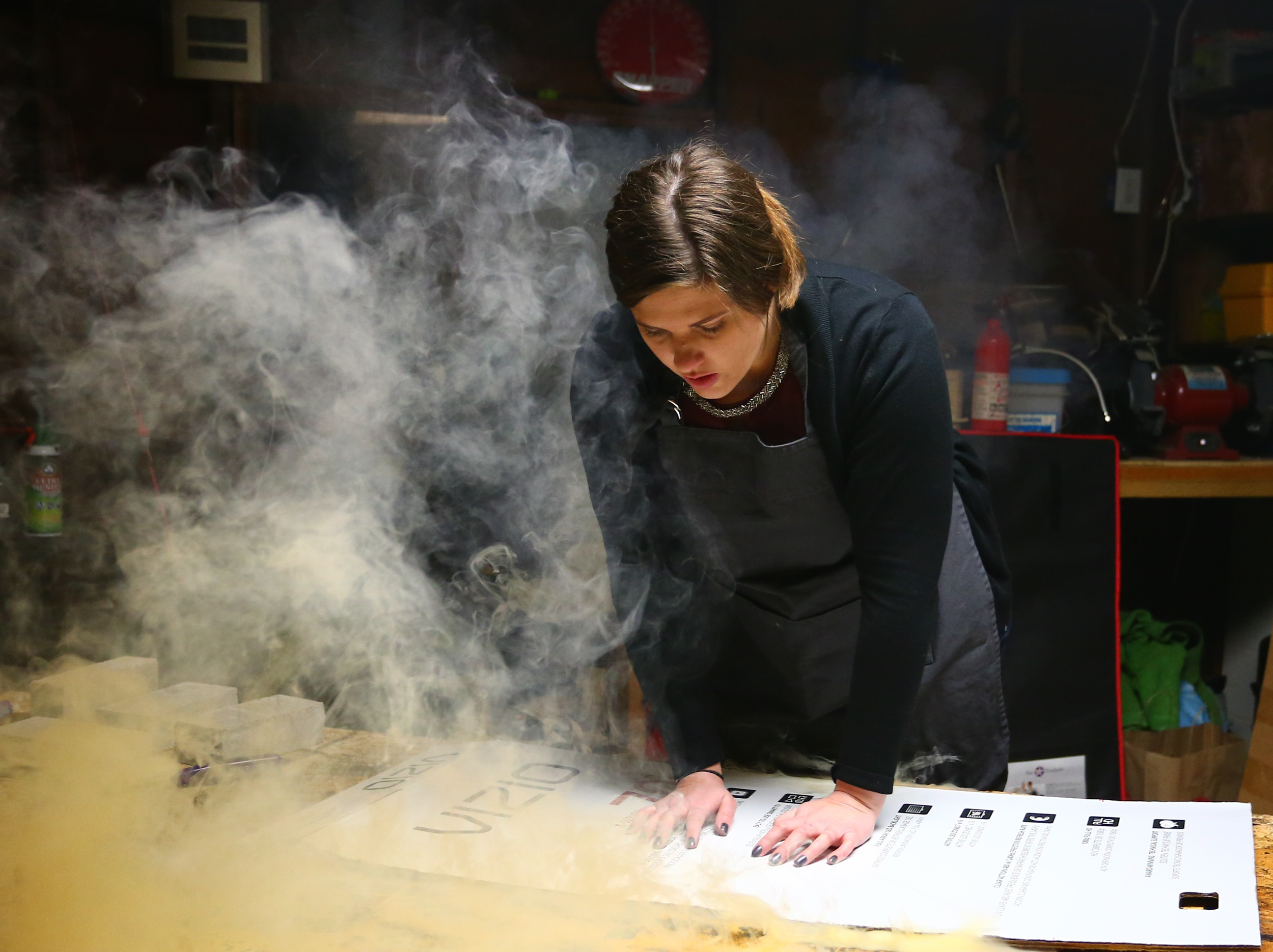 Lisa Friedrich puts pressure on different areas of the matboard during the burn to produce different levels of charring // Photo courtesy of Lisa Friedrich