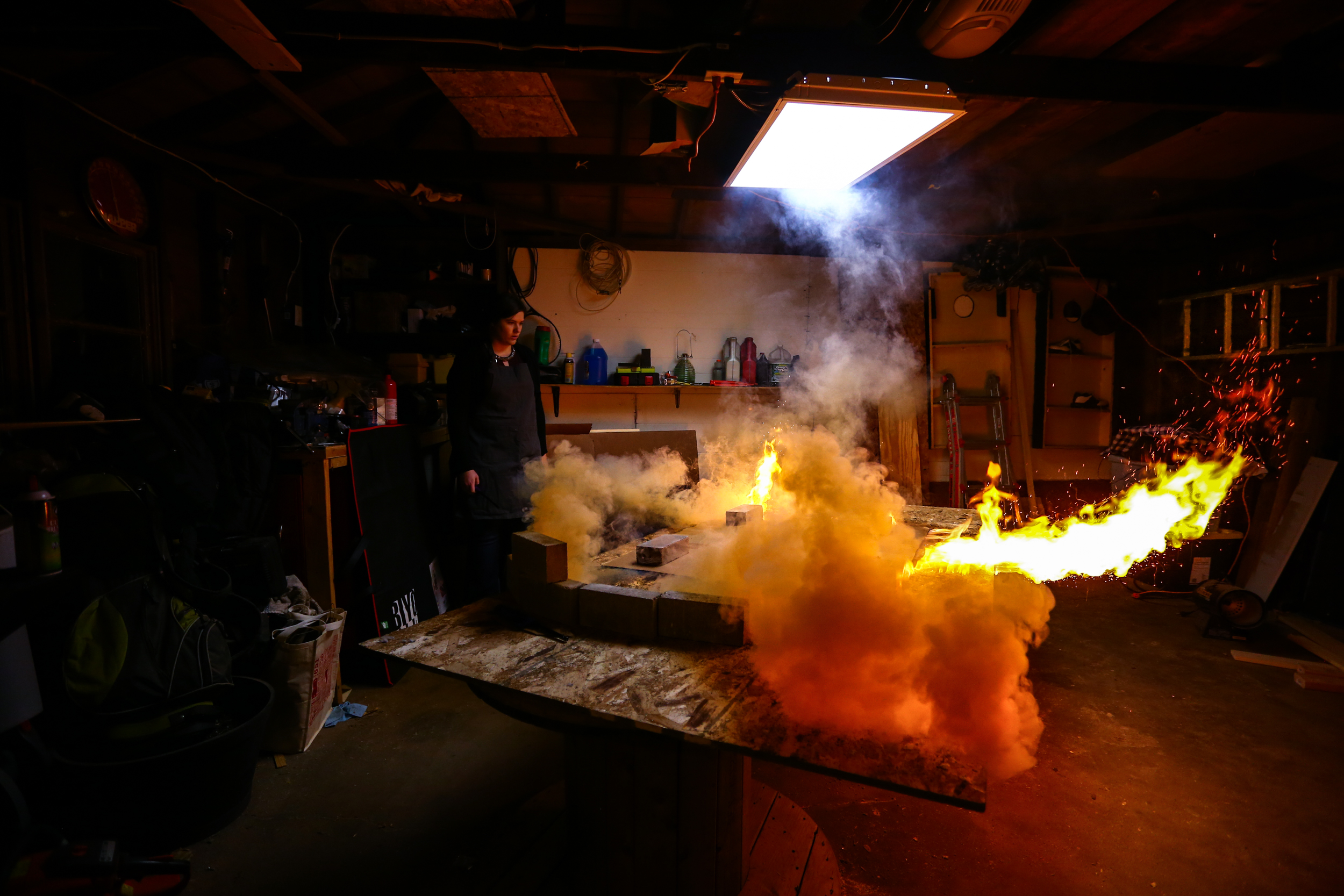 One of Lisa Friedrich's gunpowder artworks mid-burn // Photo courtesy of Lisa Friedrich