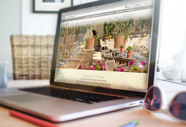 The Front Yard Website On A Laptop Screen