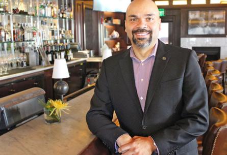 Man standing at restaurant counter