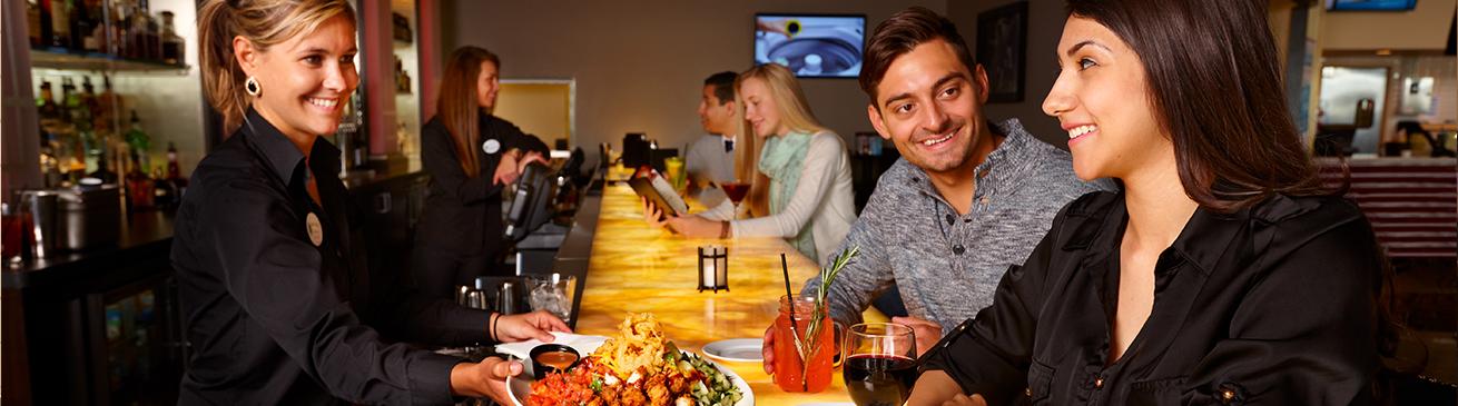 Bartender Serving Guests