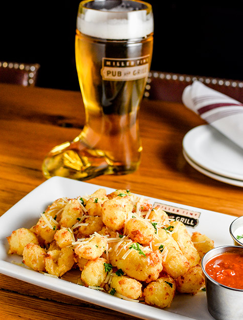 Fresh Cheese Curds and A Refreshing Pint of Beer