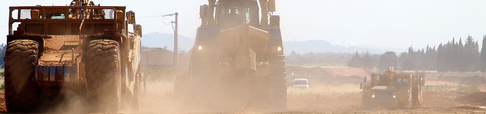 Heavy equipment driving on a job site