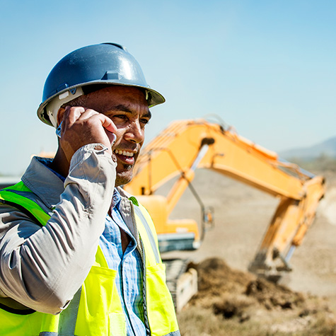 Man using phone on construction site