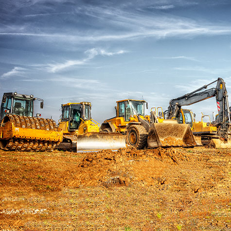 Multiple machines idle on construction yard