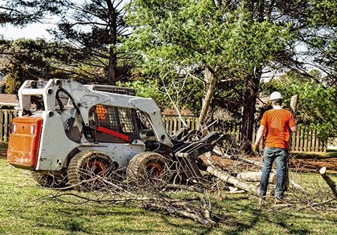 Skid steer on landscaping job