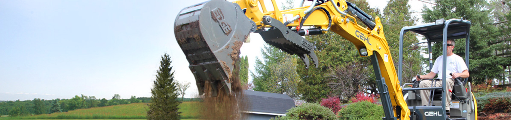 Compact Excavator Digging Hole