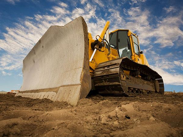 Idle bulldozer on job site
