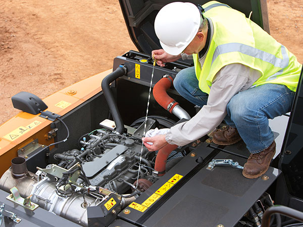 Man doing maintenance on equipment