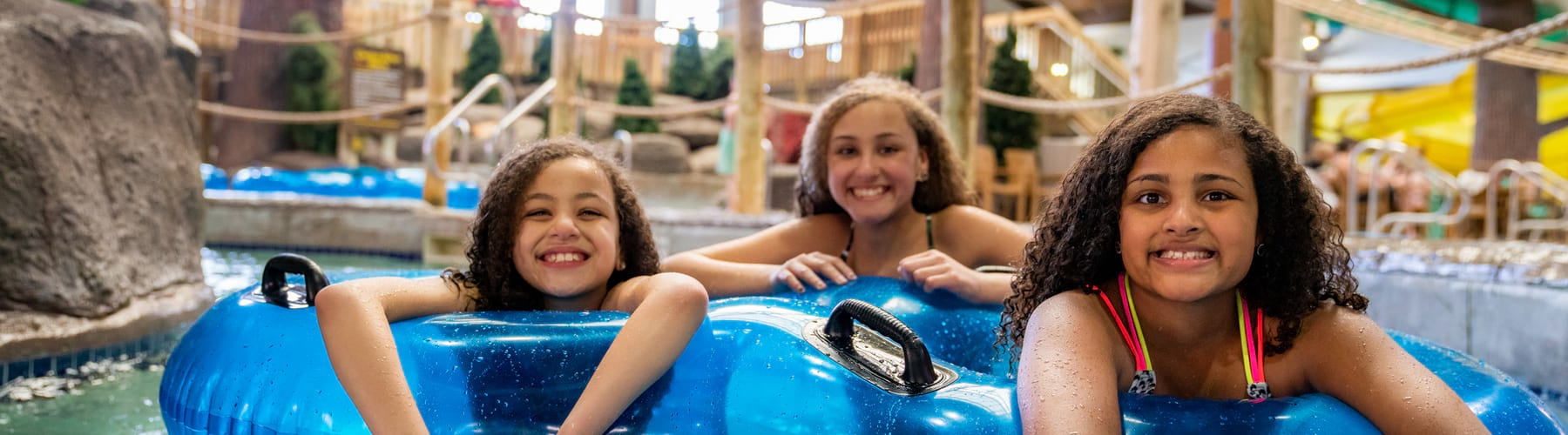 Three sisters in a tube on the lazy river