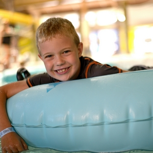 Boy on tube at waterpark