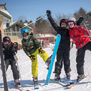 Four boys skiing