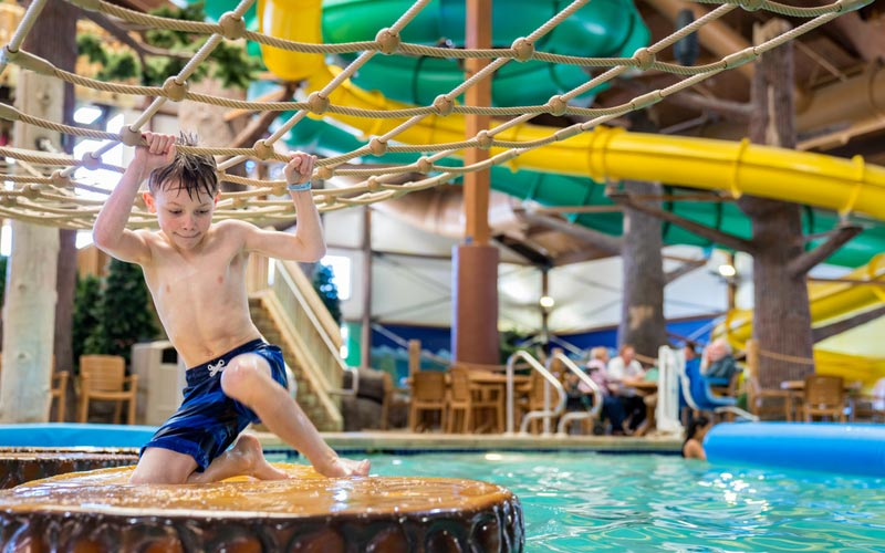 Child playing in waterpark