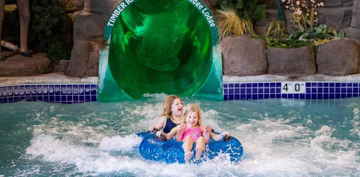children sliding down water slide